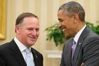 John Key and Barack Obama are facing different TPP problems. Photo / AP