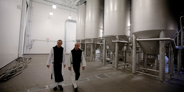 Father Damion, the abbot at St Joseph's Trappist Abbey (left) and Spencer Brewery director Father Isaac at their state-of-the-art brewery. Photo / AP