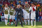Roy Hodgson leads his player in handing the applause back to England fans after the draw to Costa Rica. Photo / AP