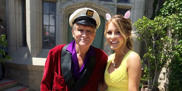 Playboy founder Hugh Hefner and his wife Crystal in front of the Playboy Mansion. Photo / Twitter @hughhefner