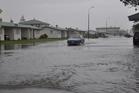 Surface flooding in Sewell Street, Hokitika this morning. Photo / Hokitika Guardian