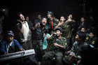 'Kachin fighters' - Soldiers of the Kachin Independence Army (KIA) drink and sing together at a funeral for one of their commanders, in the city of Laiza (Myanmar). Photo / Julius Schrank