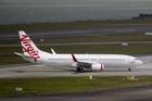 Air NZ has a 25.99% stake in Virgin Australia. Photo / Richard Robinson