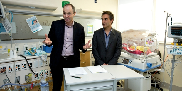 Orion Health chief  Ian McCrae (left) with Dale Bramley, CEO of the Waitemata District Health Board, at the July announcement of a collaboration designed to make some wards paperless. Photo / Dean Purcell
