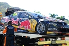 Craig Lowndes' car is taken away after a spectacular crash. Photo / Getty Images