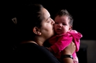 Anjula Manga with her 6-week-old baby who is yet to be named. Photo / Dean Purcell