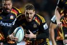 Tawera Kerr-Barlow of the Chiefs scampers from the base of a ruck. Photo / Getty Images
