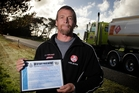 Truck driver Murray Davidson with the police commendation. Photo/Bevan Conley
