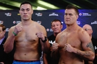 Joseph Parker (left) and Brian Minto - with Parker's trainer, Kevin Barry, in the background -- pose for the camera during yesterday's weigh-in. Photo / Getty Images