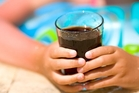 Putting a tax on sugary drinks would decrease childhood obesity and improve oral health.