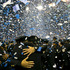 New York Police Department police officers embrace each other as confetti rains down after a Police Academy graduation ceremony at Madison Square Garden in New York. Photo / AP