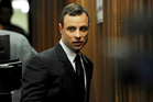 Oscar Pistorius arrives at court in Pretoria. Photo / AP