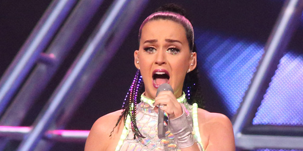 Katy Perry is being sued by Christian rapper Flame for adding 'witchcraft' elements to a sample of one of his songs. Photo/AP
