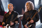 Metallica's James Hetfield and Kirk Hammett perform at the Glastonbury music festival in England. Photo/AP