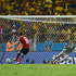 James Rodriguez slots in a penalty to get Colombia back into the game. Photo / Getty Images