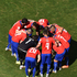 Chile's players gather in a huddle prior to kick off. Photo / Getty Images