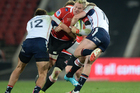 Alwyn Hollenbach of the Lions, centre, is tackled during the Super Rugby match between Lions and Melbourne Rebels at Ellis Park in Johannesburg. Photo / Getty Images