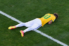 Neymar falls to the ground after Brazil beats Chile in a dramatic penalty shootout. Photo / Getty Images