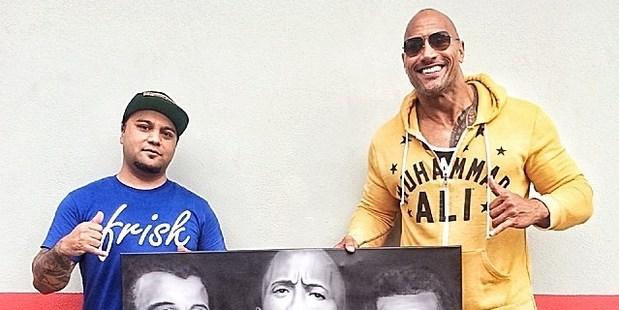 "Jason Manukau presented his artwork to Dwayne ""The Rock"" Johnson."