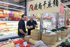 Gore farmer Michael Wilkins, left, and BNZ agribusiness client director Nathan Henry viewing products in the Shanghai Auchen supermarket. Photo / Mark Mitchell