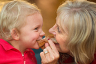 Ella Jarmey, 3, left, with her grandmother Tina Jarmey having a bite to eat at the markets