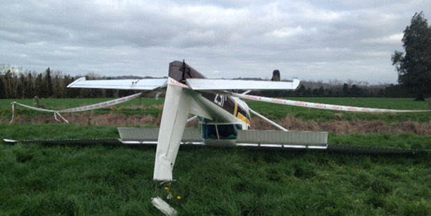 Loading A light aircraft rests upside down in a paddock in Takanini after the pilot was forced to make an emergency landing near Ardmore Airport. Photo / Sarah Ivey