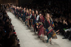 Models including Cara Delevingne wore personalised ponchos at Burberry Prorsum. Photo / Getty Images.