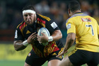 Ben Tameifuna of the Chiefs lines up Ardie Savea of the Hurricanes during the round 18 Super Rugby match between the Chiefs and the Hurricanes at Waikato Stadium. Photo / Getty Images.