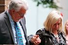 Veteran entertainer Rolf Harris holds the hand of his daughter Bindi, as they leave Southwark Crown Court following his guilty verdict. Photo / AP