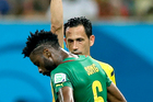 Referee Pedro Proenca from Portugal gives a red card to Cameroon's Alex Song during the group A World Cup soccer match between Cameroon and Croatia. Photo / AP