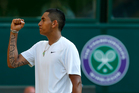 Nick Kyrgios of Australia celebrates after winning a point against Rafael Nadal at Wimbledon. Photo / AP