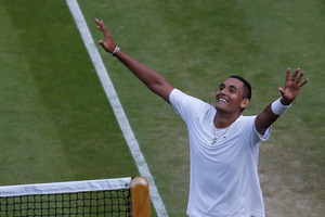 Nick Kyrgios of Australia celebrates defeating Rafael Nadal of Spain in their men's singles match on Centre Court at the All England Lawn Tennis Championships in Wimbledon. Photo / AP