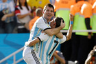 Argentina's Angel di Maria, right, and Lionel Messi celebrate after di Maria scored during the World Cup round of 16 soccer match between Argentina and Switzerland. Photo / AP
