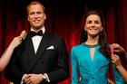 Madame Tussauds employees prepare the wax figures of Britain's Prince William, left, and his wife Kate, right, the Duchess of Cambridge, at the attraction in London. Photo / AP