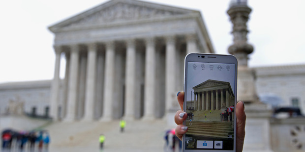 The United States Supreme Court delivered a victory for personal privacy rights last week and ruled the warrantless search of mobile phones unconstitutional. Photo / AP