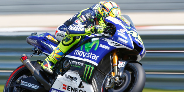 Valentino Rossi has extended his contract with Yamaha until the 2016 season. Photo / AP