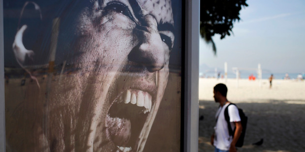 Adidas advertising featuring Uruguay's soccer striker Luis Suarez in Rio de Janeiro. Adidas has stopped using Suarez for World Cup marketing following his ban for biting an opponent. Photo / AP