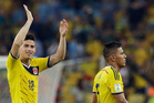 Colombia's James Rodriguez, left, waves to supporters following Colombia's 2-0 victory over Uruguay. Photo / AP