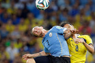 Uruguay's Cristian Rodriguez, left, and Colombia's Abel Aguilar go for a header during their World Cup round of 16 soccer match at Maracana Stadium in Rio de Janeiro. Photo / ap