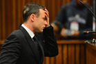 Oscar Pistorius listens to evidence in court in Pretoria as his murder trial resumed. Photo / AP
