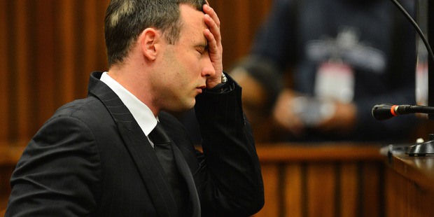 Loading Oscar Pistorius listens to evidence in court in Pretoria as his murder trial resumed. Photo / AP