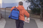 SCHOOL02NZH - A young boy arrives at the Browns Bay Primary School at 00803hrs June 20. Youngsters are going to school earlier as both parents head of to employment. --NOTE THE TIME COMES FROM TH
