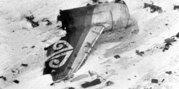 The battered tail of the ill-fated DC-10 lying on its side surrounded by wreckage.