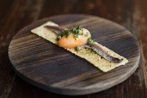 Frank Camorra's tomato-anchovy crostini - a staple on the MoVida menu. Photo / Supplied.