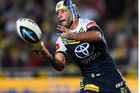 North Queensland's Johnathan Thurston passes the ball during the match between the North Queensland Cowboys and the South Sydney Rabbitohs in Townsville on Saturday night. Photo / Getty Images