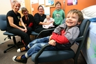 Fabian Ritchie-Warren, aged 4, is all smiles before getting immunised against measles at Whangarei's Bush Road Medical Centre yesterday. With him from left are practice nurses Laura Bransby and Fiona Alexander, mum Sarah Ritchie-Warren and siblings Sage Ritchie-Warren, 10 weeks old, and Brock Ritchie-Warren, 7. Photo / Michael Cunningham