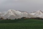 The snow-capped Ruahine Range behind Dannevirke on Thursday morning. Photo / Christine McKay