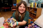 Macayla McAlley, 11, would have made more than 200 loom bands since her time in hospital in May.Photo/Ruth Keber