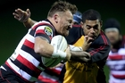 Counties Manukau halfback Kane Hancy fends off Wliiiam Tamanalevu last night. Photo / Getty Images
