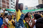 Brazil fans celebrate their team's dramatic win over Chile. Photo / Getty Images